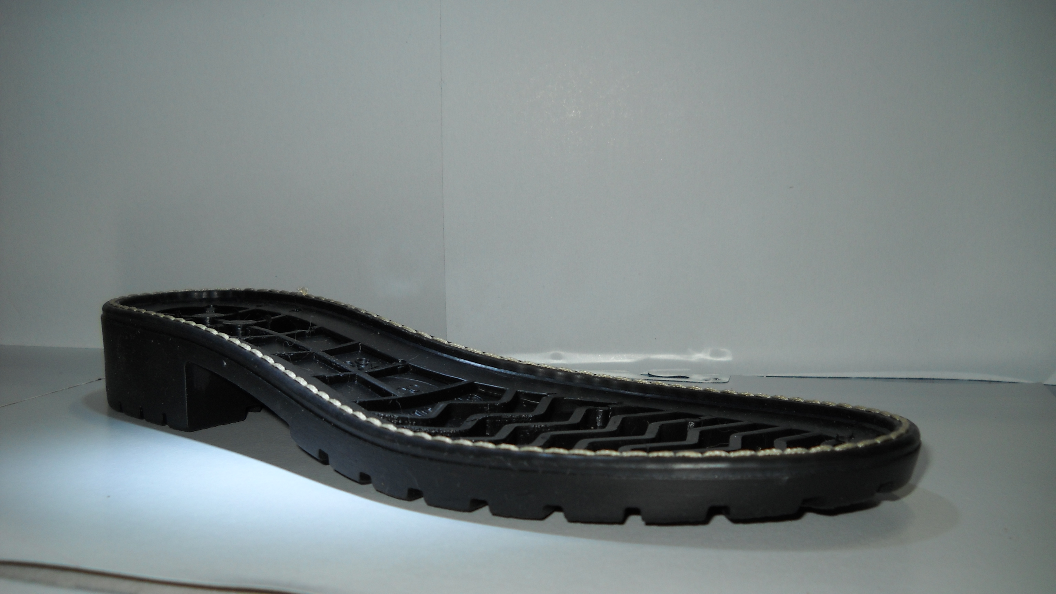 Claudia TPR sole with applied rim (2011)